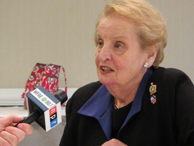 Former Secretary of State Madeleine Albright, known for her pins is wearing an Obama pin and a Charlotte crown.