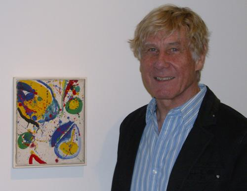 Andreas Bechtler poses with his first art purchase, which he acquired at age 16.