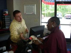 E.J. Paustian works with a customer at a AAA Car Care Center in north Charlotte. hspace=4