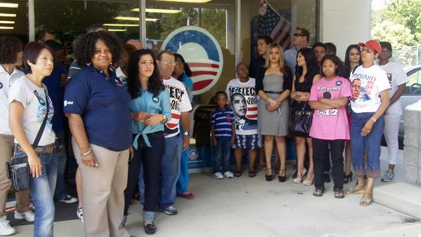Volunteers and supporters stand outside of a campaign office in east Charlotte, waiting to take a picture with San Antonio Mayor Julian Castro.