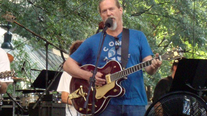 Jeff Bridges runs a sound check with his band, the Abiders, Monday morning as he prepares for CarolinaFest at Trade and Tryon Streets.