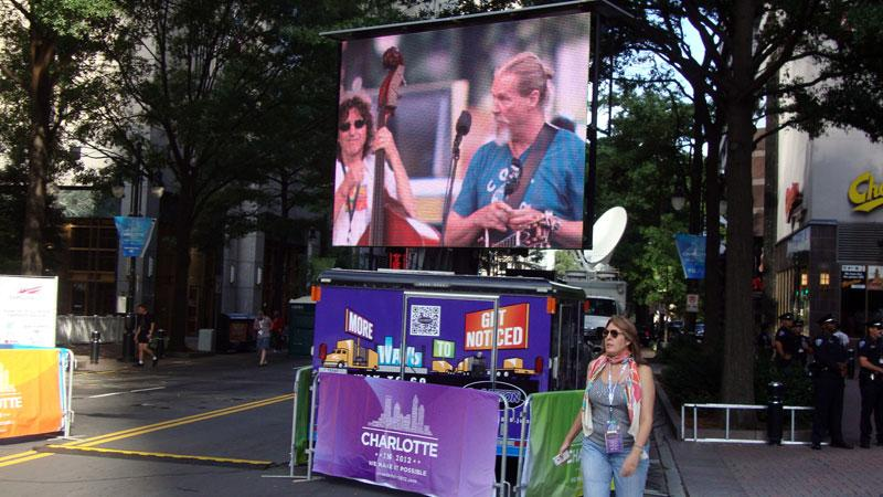 Actor and singer Jeff Bridges appears on a jumbo screen at CarolinaFest Monday as he checks his sound gear.