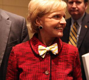 Former NC Governor Bev Perdue sports a yellow bowtie to the Chiquita jobs announcement.