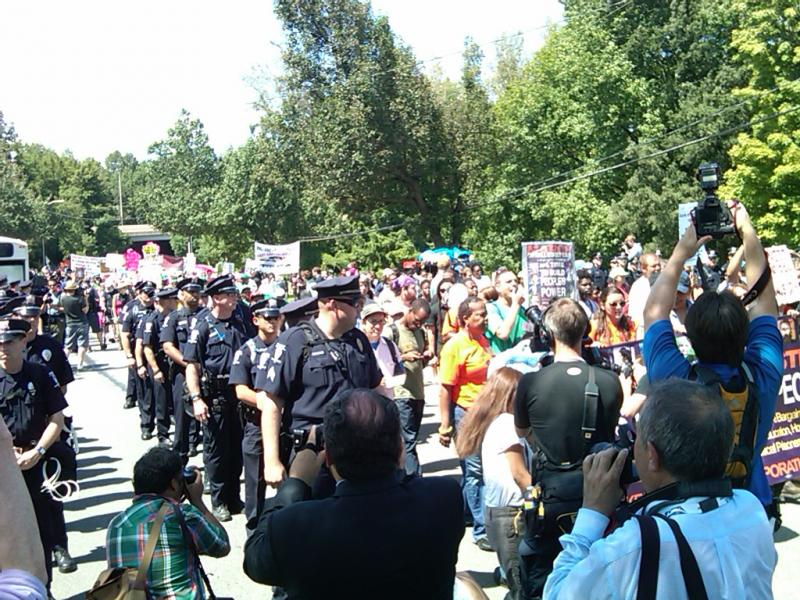 Police lined up on either side of the marchers to escort them.