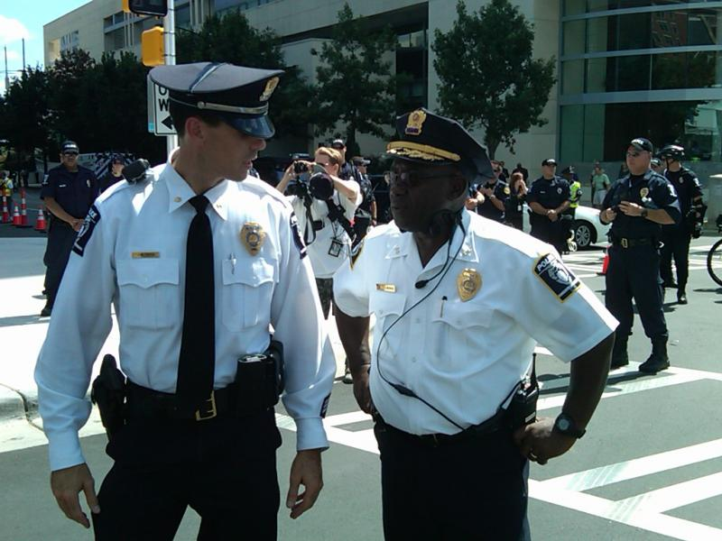 Major Jeff Estes conferring with CMPD Chief Rodney Monroe at the front of the march.