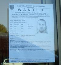 As search continues for Brinkley, such wanted signs are posted around Lenoir. hspace=2
