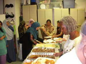 The buffet line at a dinner marking end of day of fasting during Ramadan.