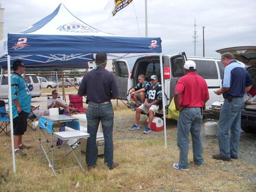 Fans tailgate before a Carolina Panthers game.