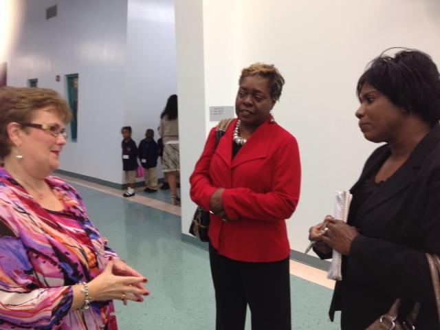 Nancy Lewis shows visitors from Charlotte Choice around Sugar Creek Charter school.