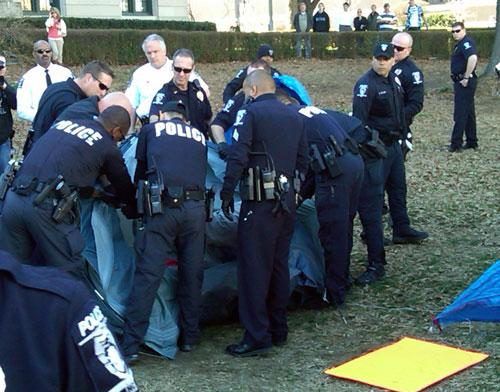 CMPD officers surround the tent of an Occupy Charlotte protester that refused to come out.