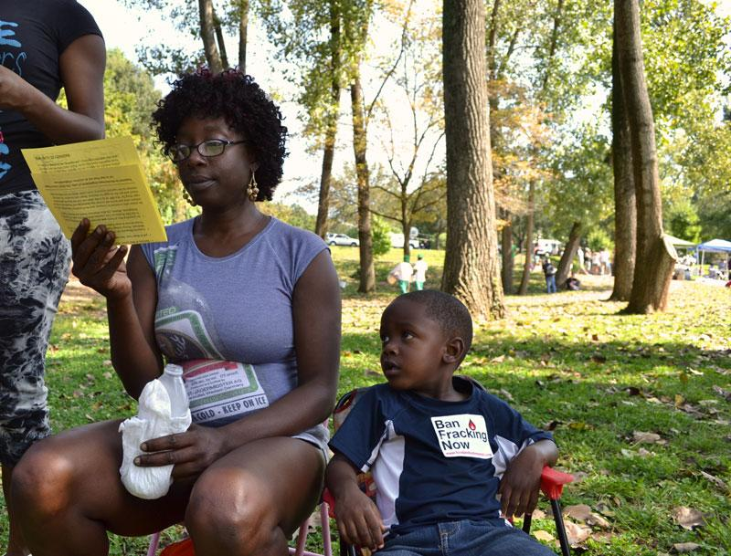 Natanya Jackson sits with her son Cornell in Frazier Park before the March on Wall Street South. Natanya's daughter was in the Grier Height Steppers.