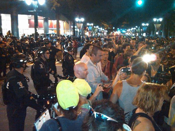 Protesters march along Tryon Street on the last night of the DNC.
