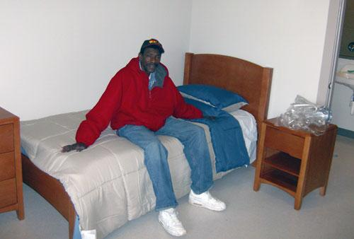 Billy Riley the bedroom of his new apartment at Moore Place.