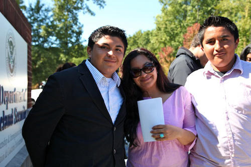 Rodrigo Cruz (left) stands with his mother Angelica and brother Silvio.