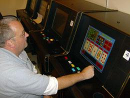 Wayne Robbins plays video poker. align=left
