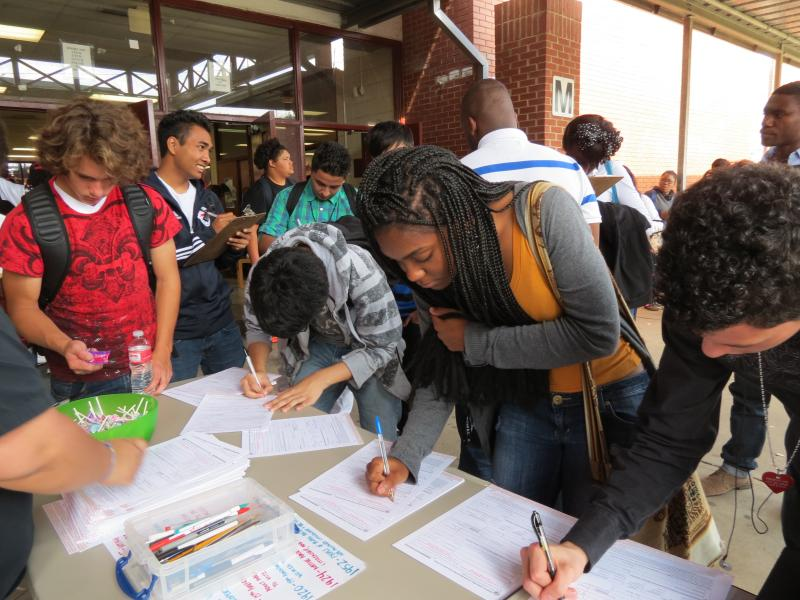Students at the West Mecklenburg High School fill out voter registration forms during lunch.