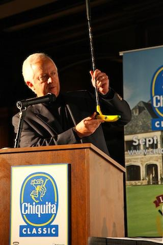 Chiquita CEO Fernando Aguirre shows off a custom made banana putter.