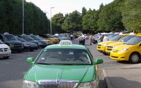 Charlotte cab drivers wait for fares in airport parking lot align=left