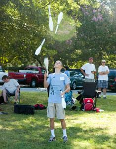 A young juggler keeping lots of pins in the air. Photo: David Boraks/DavidsonNews.net. align=left