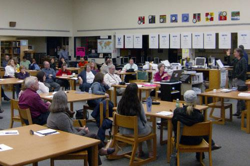 "Teachers and parents in the Media Center at East Meck High School last night discussing a plan to oppose the district's ""pay"