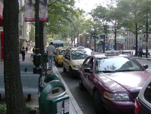 Taxis wait for passengers on an Uptown Charlotte street.