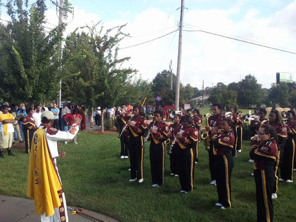 The West Charlotte High School marching band performs for those people waiting to enter The Fillmore to see Vice President Joe Biden.