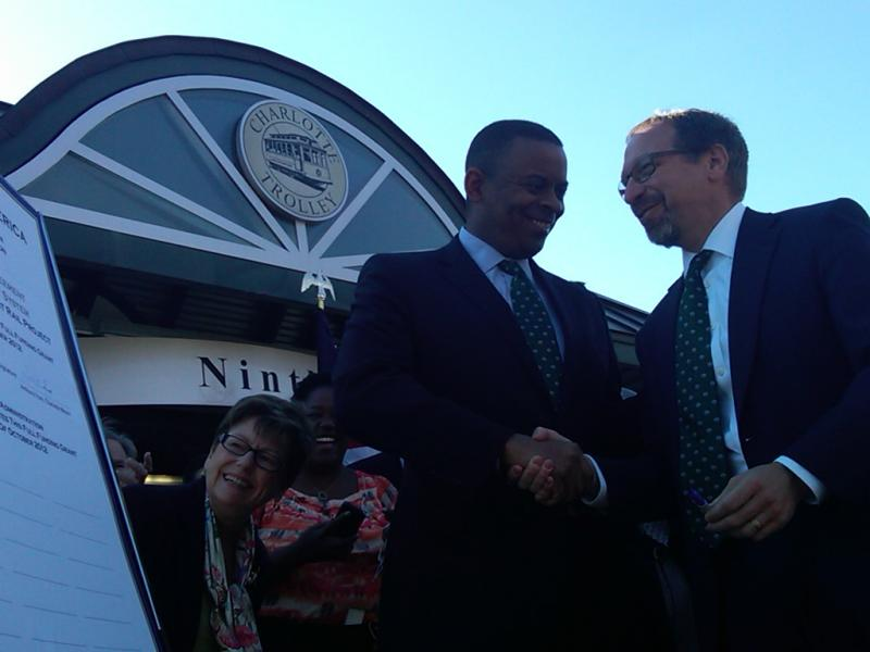 "Charlotte Mayor Foxx and FTA Administrator Peter Rogoff shake hands after signing a ""Full Funding Grant Agreement"" for the Blue Line Extension."