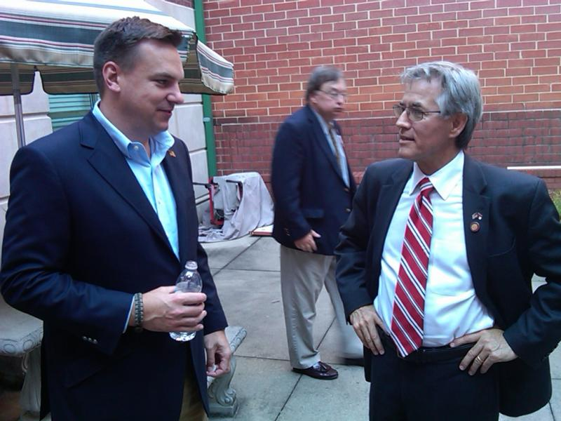 Republican Richard Hudson (l) chats with a supporter at a rally in Salisbury, NC.