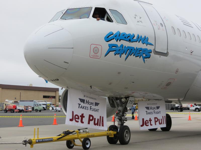 The 26 teams pulled this 50-ton Carolina Panthers-themed Airbus A319.