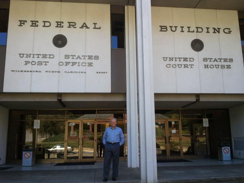 Wilkesboro Mayor Mike Inscore stands in front of the federal courthouse