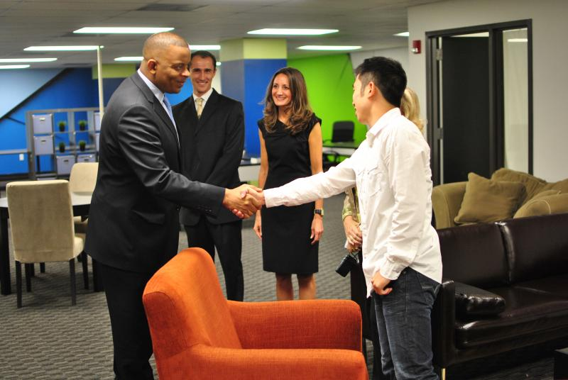 Mayor Anthony Foxx shakes hands with Ben Lee, founder of AutoPilot. Two other RevTech entrepreneurs, Flaviu Simihaian, founder of iMedicare and Lenore Vassil, founder of the Torch are also pictured.