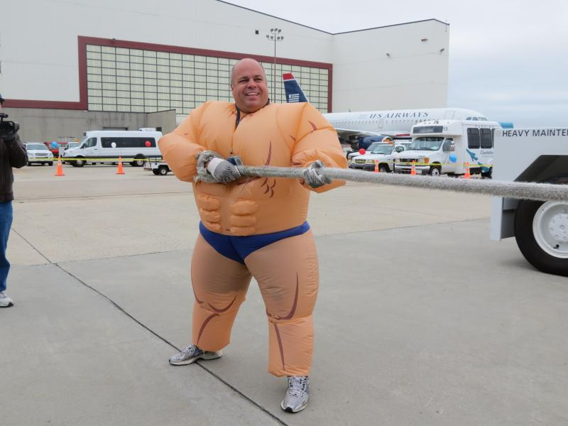 Michael Nagy, with US Airways airport customer service,  dressed up as a sumo wrestler for the event.