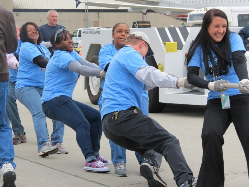 U.S. Airways employees compete in the seventh annual Jet Pull event.  The Dual Lane Demons finished with a time of 7.410.