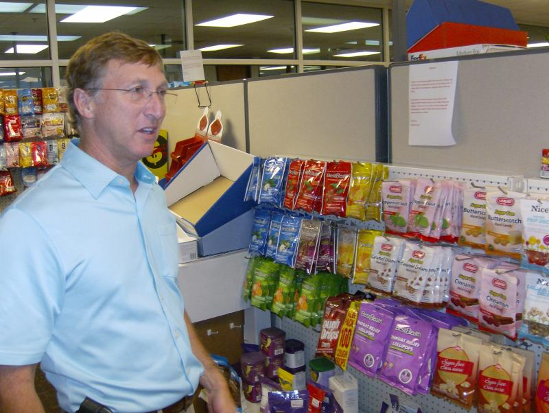 BestSweet CEO Richard Zulman and an assortment of lozenges, supplements and antacids his company manufactures in Mooresville.