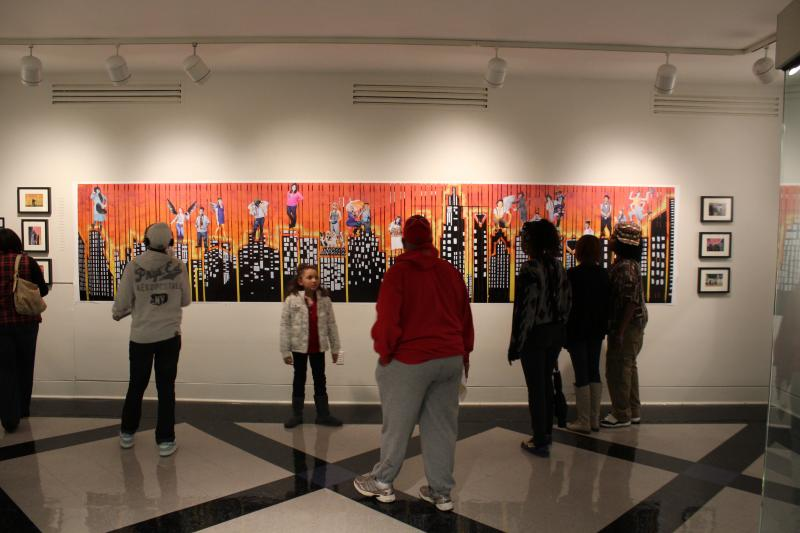 Students with Studio345's photography class created a collage that later became a mural in NoDa.