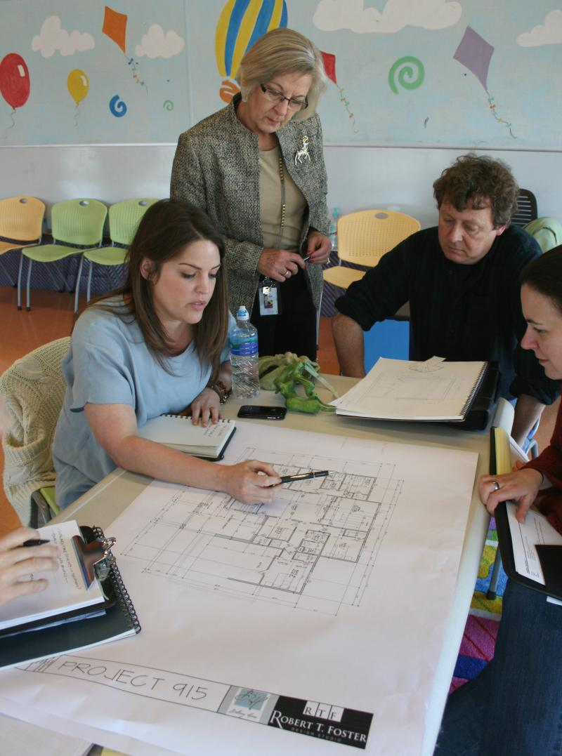 Andrew Gibbon, in black, is a set designer at the Children's Theatre of Charlotte. He designed one of the rooms on an upcoming episode of Extreme Makeover: Home Edition.