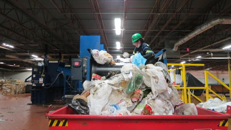 "What comes off the end of the conveyor belt is ""true trash."" The Charlotte airport has reduced the trash it sends to the landfill by 70%."
