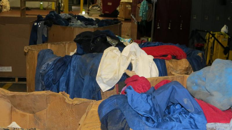 Airplane blankets and clothing discarded by passengers end up at the recycling center.  The clothing is laundered and donated to charity by volunteers.