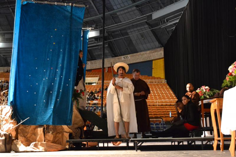 Carmelo Vargas waits backstage before playing Juan Diego in a performance at the celebration for at Bojangles' Coliseum.  The Virgin Mary is believed to have revealed herself to him in the 16th Century.