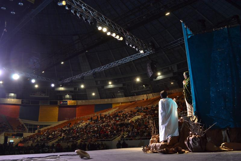 Besey Gomez and Carmelo Vargas play the Virgin of Guadalupe and Juan Diego in the play in front of about five thousand people at Bojangles' Coliseum on Tuesday night.