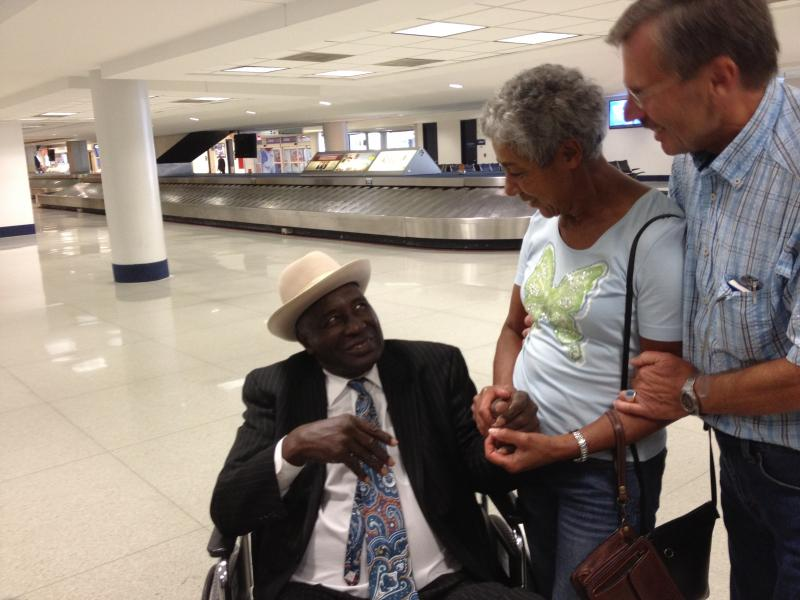 From left, Ross Walker talks to daughter Elvira Breu Rypacek and her husban, Raimun Briechles in October at Charlotte Douglas International Airport.