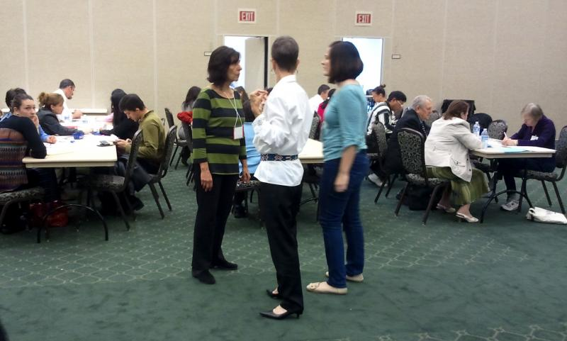 Legal immigrants work through citizenship applications with volunteers at a local workshop.