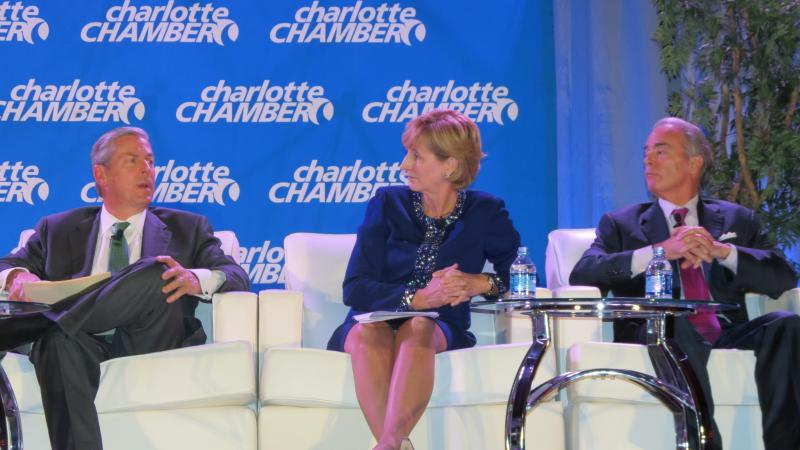 Wells Fargo senior executive vice president David Carroll, Premier Inc CEO Susan DeVore and Duke Energy CEO Jim Rogers at the Charlotte Chamber Economic Outlook luncheon on December 17, 2012.