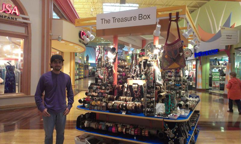 Aamir Saleem helps his parents look after a kiosk selling Indian-style accessories at the Concord Mills mall.
