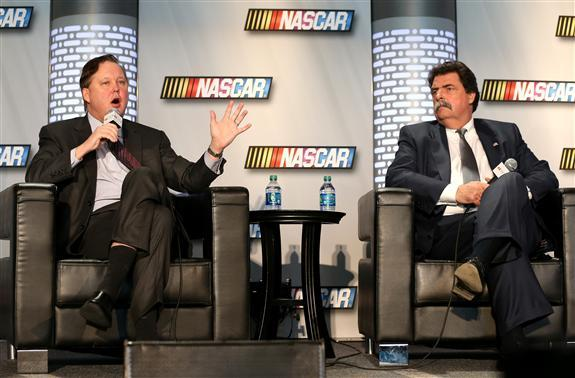 NASCAR CEO Brian France and President Mike Helton discuss the new race car during a press conference in uptown Charlotte.