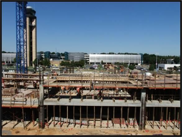 A $120 million, 7-story parking structure is underway to replace the current hourly parking decks at Charlotte-Douglas International Airport. In the coming weeks, the existing parking decks will be demolished.