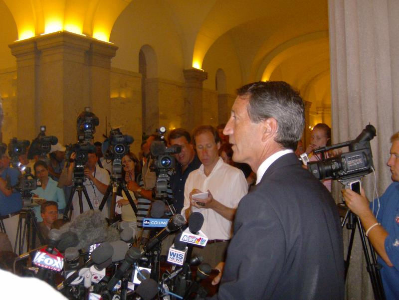 Former South Carolina Governor Mark Sanford faced a sea of reporters in the state capitol rotunda on June 25, 2009 to explain the reason for his mysterious five-day absence: a trip to visit his mistress in Argentina.