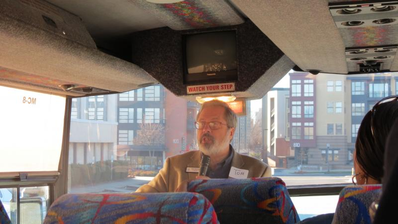 Historian Tom Hanchett leads the bus tour around the city.