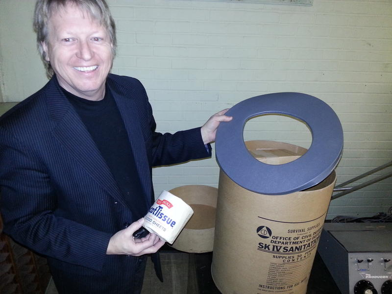 WBT chief engineer Jerry Dowd shows off the all-important sanitation kit that came standard with the station's 1963-era nuclear bomb shelter.