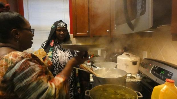 Fatu Bangura and daughter, Theresa Macon prepare an African feast